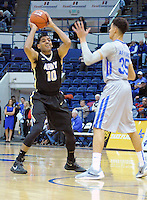 December 12, 2015 - Colorado Springs, Colorado, U.S. -  Army forward, Kennedy Edwards #10, looks to make a pass during an NCAA basketball game between the Army West Point Black Knights and the Air Force Academy Falcons at Clune Arena, U.S. Air Force Academy, Colorado Springs, Colorado.  Army West Point defeats Air Force 90-80.