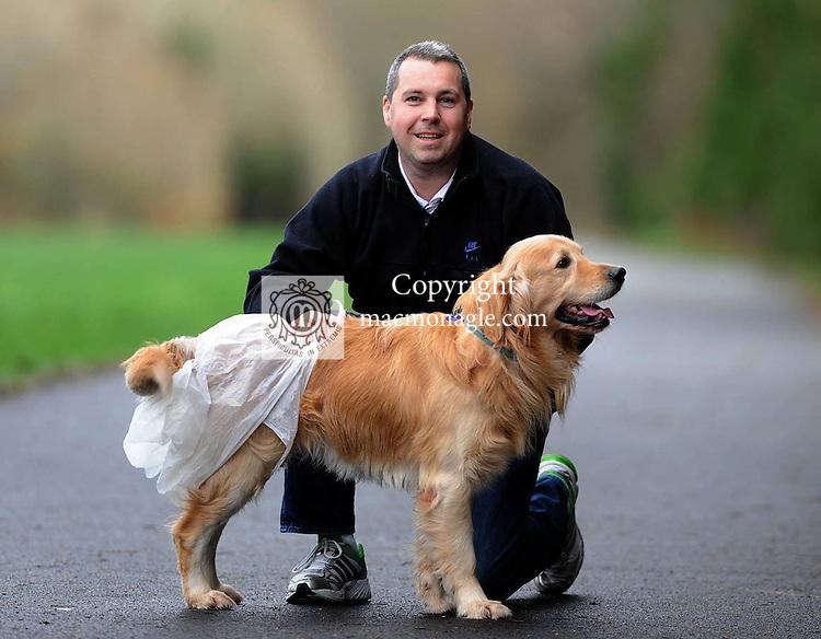 Killarney Town Councillor Niall 'Botty' O'Callaghan walking Golden Retriever 'Buzz' with a plastic nappy device attached  in Killarney National Park . Picture: Eamonn Keogh (MacMonagle, Killarney).  STORY: John O'Mahony