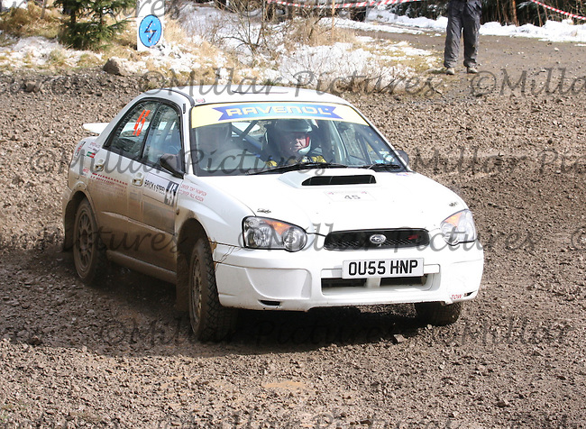 Tony Thompson - Paul Hudson in a Subaru Impreza at Junction 6 on Special Stage 1 Riccarton on the Brick & Steel Border Counties Rally 2014, Round 2 of the RAC MSA Scottish Rally Championship sponsored by ARR Craib Transport Limited and other championships  and organised by Whickham & District and Hawick & Border Car Clubs and based in Jedburgh and held in Kielder Forest on 22.3.14.