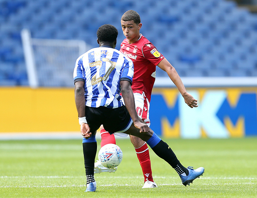 Nottingham Forest's Brennan Johnson under pressure from Sheffield Wednesday's Dominic Iorfa <br /> <br /> Photographer Rich Linley/CameraSport<br /> <br /> The EFL Sky Bet Championship - Sheffield Wednesday v Nottingham Forest - Saturday 20th June 2020 - Hillsborough - Sheffield <br /> <br /> World Copyright © 2020 CameraSport. All rights reserved. 43 Linden Ave. Countesthorpe. Leicester. England. LE8 5PG - Tel: +44 (0) 116 277 4147 - admin@camerasport.com - www.camerasport.com