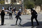 Palestinian protesters hurl stones towards Israeli security forces during clashes following a weekly demonstration against the expropriation of Palestinian land by Israel in the village of Kfar Qaddum, near the West Bank city of Nablus on September 20, 2019. Photo by Shadi Jarar'ah