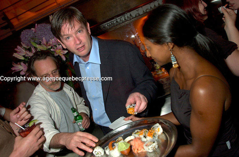 June 4 2002, Montreal, Quebec, Canada<br /> <br /> <br /> Humorist Mark Mckinney (M) and an unidentified partygoer (L), enjoy Suchis from SOTO restaurant, served bywaitress iMarie-Soleil Lavoie (R) <br />  at ilume club, in Montreal, JUne 4, 2002 after the opening of McKinney's play ; Fully Committed.<br /> <br /> Formelly of The Kids In The Hall Canadian TV show, McKinney now based in New York, plays in movies and TV series such as DICE, Brain Candy, ... as well as doing comedy and theater.<br /> <br /> Mandatory Credit: Photo by Pierre Roussel- Images Distribution. (&copy;) Copyright 2002 by Pierre Roussel <br /> <br /> NOTE :l Nikon D-1 jpeg opened with Qimage icc profile, saved in Adobe 1998 RGB.