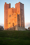 Late afternoon winter sunshine shining on walls of Orford Castle, Orford, Suffolk, England