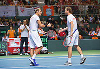 Switserland, Genève, September 19, 2015, Tennis,   Davis Cup, Switserland-Netherlands, Doubles: Dutch team Matwe Middelkoop/Thiemo de Bakker (L)  in the background Captan Jan Siemerink <br /> Photo: Tennisimages/Henk Koster