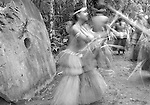 Motion blur of Yapese traditional dancers performing Stick Dance in front of Stone Money, Yap, Micronesia, Pacific Ocean (No MR)