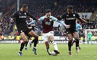 Burnley's Dwight McNeil holds off the challenge from Barnsley's Ethan Pinnock (left) and Dimitri Cavare<br /> <br /> Photographer Rich Linley/CameraSport<br /> <br /> Emirates FA Cup Third Round - Burnley v Barnsley - Saturday 5th January 2019 - Turf Moor - Burnley<br />  <br /> World Copyright &copy; 2019 CameraSport. All rights reserved. 43 Linden Ave. Countesthorpe. Leicester. England. LE8 5PG - Tel: +44 (0) 116 277 4147 - admin@camerasport.com - www.camerasport.com