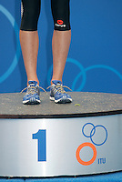 31 AUG 2007 - HAMBURG, GER - Britains Hollie Avil stands on top of the podium after her victory - Junior Womens World Triathlon Championships. (PHOTO (C) NIGEL FARROW)