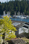 View of boats at anchor above the roof tops in Deep Cove,Vancouver, British Columbia, Canada.