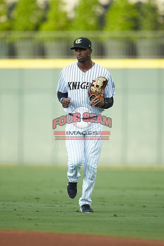 Charlotte Knights center fielder Luis Robert (9) jogs off the field between innings of the game against the Gwinnett Braves at BB&T BallPark on July 12, 2019 in Charlotte, North Carolina. The Stripers defeated the Knights 9-3. (Brian Westerholt/Four Seam Images)