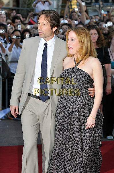 "DAVID DUCHOVNY & GILLIAN ANDERSON.Arrivals - ""The X-Files: I Want to Believe"".UK  film premiere held at Empire Cinema, Leicester Square, London, England, 30th July 2008..X files arrivals half 3/4 length black print halterneck maxi dress pregnant tie beige grey suit jacket.CAP/PL.©Phil Loftus/Capital Pictures"