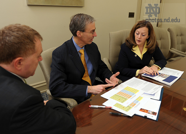 Vice President of Finance John Sejdinaj meets with staff...Photo by Matt Cashore/University of Notre Dame