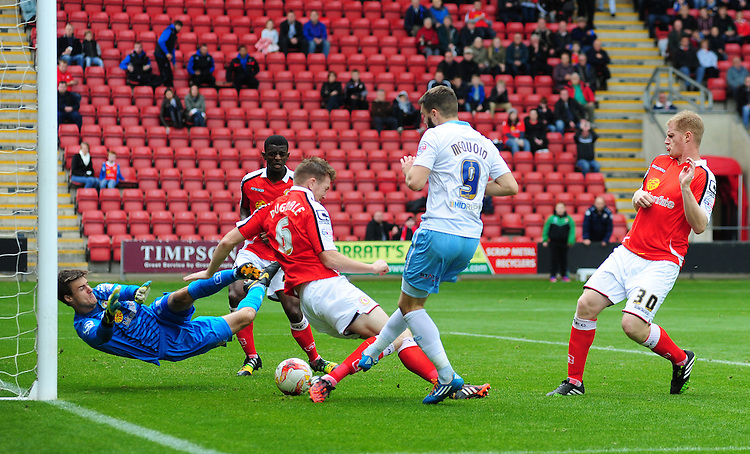 Crewe Alexandra's Ben Garratt makes a save at the feet of Coventry City's Josh McQuoid<br /> <br /> Photographer Chris Vaughan/CameraSport<br /> <br /> Football - The Football League Sky Bet League One - Crewe Alexandra v Coventry City - Saturday 11th October 2014 - Alexandra Stadium - Crewe<br /> <br /> &copy; CameraSport - 43 Linden Ave. Countesthorpe. Leicester. England. LE8 5PG - Tel: +44 (0) 116 277 4147 - admin@camerasport.com - www.camerasport.com