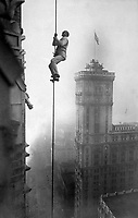 "The ""Human Squirrel"" who did many daring ""stunts"" in climbing for benefit of War Relief Funds in New York City.  He is shown here at a dizzy height in Times Square.  Ca.  1918.  Times Photo Service. (War Dept.)<br /> Exact Date Shot Unknown<br /> NARA FILE #:  165-WW-578B-6<br /> WAR & CONFLICT BOOK #:  521"