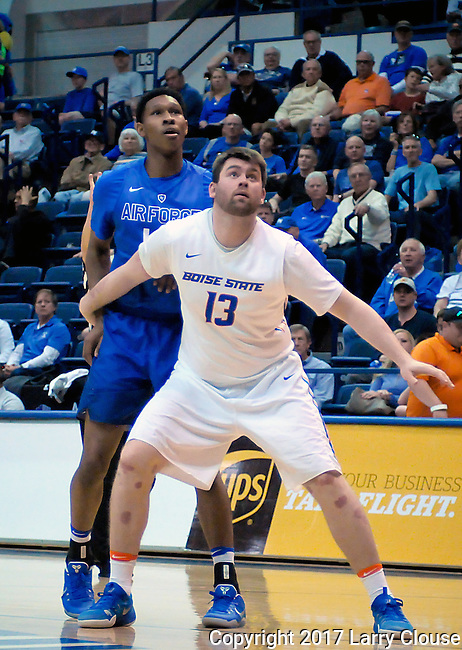 March 4, 2017:   Boise State forward, Nick Duncan #13, controls the lane during the NCAA basketball game between the Boise State Broncos and the Air Force Academy Falcons, Clune Arena, U.S. Air Force Academy, Colorado Springs, Colorado.  Boise State defeats Air Force 98-70.