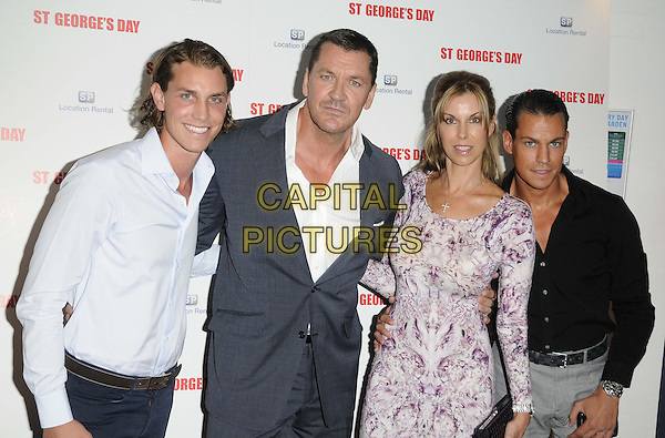 Craig Fairbrass & Elke Fairbrass (centre) & guests.The 'St George's Day' world film premiere, Odeon Covent Garden cinema, Shaftesbury Avenue, London, England..August 29th, 2012.half length black blue purple suit dress print married husband wife .CAP/CAN.©Can Nguyen/Capital Pictures.