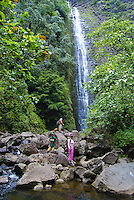 Hikers take a break just before Halawa Falls (left fork), Molokai