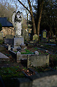 London, UK. 11.01.2015. Angel statue on grave, Highgate East Cemetery, London, UK. Photograph © Jane Hobson.