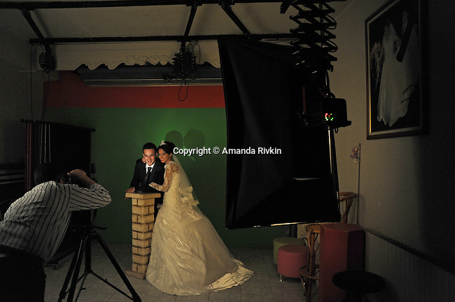 Bride Dilek Duvarci, 24, and groom Oguzhan Duvarci, 26, pose for wedding portraits in a studio in Erzurum, Turkey on August 8, 2010. Erzurum the first major city near the route of the Baku-Tbilisi-Ceyhan oil pipeline in Turkey, located just 10 kilometers from the pipeline which traverses numerous villages near the city's airport.