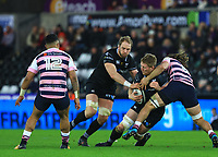 Ospreys' Bradley Davies is tackled by Cardiff Blues' Josh Navidi.<br /> <br /> Photographer Dan Minto/CameraSport<br /> <br /> Guinness Pro14 Round 13 - Ospreys v Cardiff Blues - Saturday 6th January 2018 - Liberty Stadium - Swansea<br /> <br /> World Copyright &copy; 2018 CameraSport. All rights reserved. 43 Linden Ave. Countesthorpe. Leicester. England. LE8 5PG - Tel: +44 (0) 116 277 4147 - admin@camerasport.com - www.camerasport.com