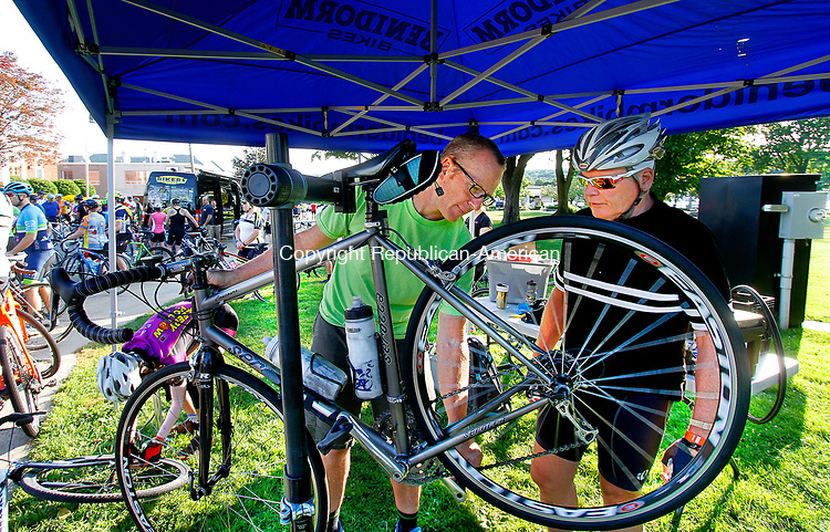 TORRINGTON, CT - 06 AUGUST 2017 - 080617JW02.jpg -- Cyclist Tom Hodgkin of Norfolk gets a pre-tour bike check from Benidorm Bikes Doug Tanner during the Tour of Litchfield Hills bike ride Sunday morning at Coe Memorial Park.  Jonathan Wilcox Republican-American