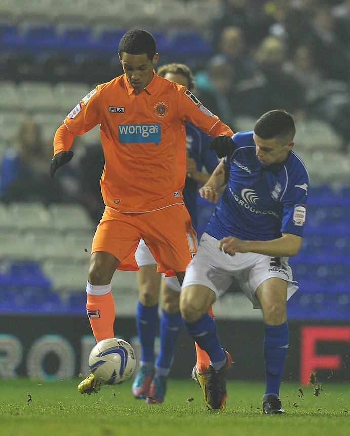 Blackpool's Thomas Ince battles with Birmingham City's Callum Reilly..Football - npower Football League Championship - Birmingham City v Blackpool - Tuesday 05th March 2013 - St Andrews - Birmingham..© CameraSport - 43 Linden Ave. Countesthorpe. Leicester. England. LE8 5PG - Tel: +44 (0) 116 277 4147 - admin@camerasport.com - www.camerasport.com