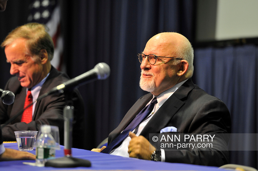 Governor Howard B. Dean III (left), Edward J. Rollins (right) are panelists at &quot;Change in the White House? Comparing the George W. Bush and Barack Obama Presidencies&quot; on Thursday, April 19, 2012, at Hofstra University, Hempstead, New York, USA. Hofstra's event was part of <br /> &quot;Debate 2012: Pride, Politics and Policy&quot; which leads up to the Presidential Debate Hofstra is hosting on October 15, 2012. Governor Howard B. Dean III, is a former Democratic National Committee Chairman, presidential candidate, six term Governor of Vermont, and physician. Edward J. Rollins managed President Ronald Reagan's 49 state landslide reelection campaign in 1984, and had major managerial roles in nine other Presidential campaigns.