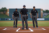 (From left to right) Umpires Malachi Moore, Junior Valentine, Erich Bacchus, and Jose Navas meet at home plate before an Arizona Fall League game between the Glendale Desert Dogs and Scottsdale Scorpions on September 20, 2019 at Salt River Fields at Talking Stick in Scottsdale, Arizona. Scottsdale defeated Glendale 3-2. (Zachary Lucy/Four Seam Images)