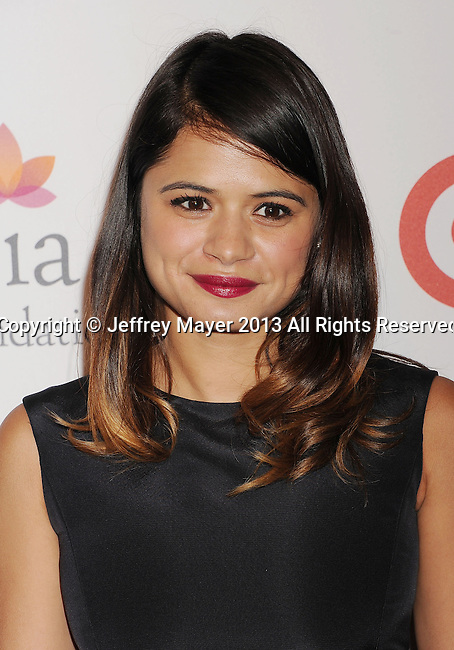 HOLLYWOOD, CA- SEPTEMBER 28: Actress Melonie Diaz arrives at the Eva Longoria Foundation Dinner at Beso restaurant on September 28, 2013 in Hollywood, California.