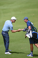 Paul Casey (GBR) and his caddie, John McLaren have a little fun to celebrate after he holed out his approach shot on 14 during round 2 of the World Golf Championships, Mexico, Club De Golf Chapultepec, Mexico City, Mexico. 2/22/2019.<br /> Picture: Golffile | Ken Murray<br /> <br /> <br /> All photo usage must carry mandatory copyright credit (© Golffile | Ken Murray)