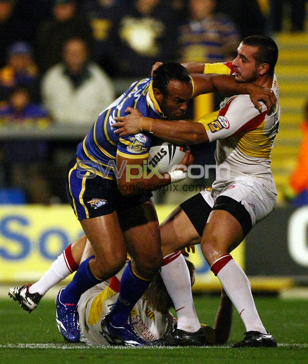 PICTURE BY VAUGHN RIDLEY/SWPIX.COM - Rugby League - Super League Playoffs - Leeds v Catalans - Headingley, Leeds, England  - 02/10/09...Copyright - Simon Wilkinson - 07811267706...Leeds Jamie Jones-Buchanan is tackled by Catalans Vincent Duport.