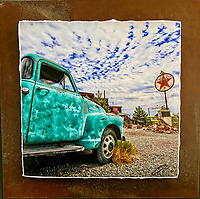 """Texaco Chevy - Mixed Media - Nevada<br /> <br /> Each unique piece is made to order. If I have the piece in stock I can ship it in 2-3 days. If I don't have it in stock and it has to be made, it will ship in 1-2 weeks. Feel free to contact me at chey.rouse@gmail.com before you order if you need the piece ASAP. <br /> <br /> The photograph is printed on a Silk photo paper, the edges of the photo are torn, photo is mounted to foam board, then I mount it to an 8""""x8"""" piece of rusted metal. The rust is unique on each piece...no two pieces are alike. PLEASE keep in mind that the rust on the piece(s) you receive may be slightly different than the photo. Each piece of metal is sealed after it is done """"rusting"""" and is titled, hand signed and, ready to hang. To see the detail for theses Mixed Media pieces please click on the 1st photo in this gallery. You will be able to see the detail of the torn paper edge as well as the back of the piece."""