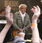 "NEW YORK, NY - JUNE 14:  Mick Jones of Foreigner performs at ""FOX & Friends"" All American Concert Series outside of FOX Studios on June 14, 2013 in New York City.  (Photo by Walter McBride/FilmMagic)"