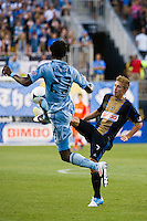Brian Carroll (7) of the Philadelphia Union and Kei Kamara (23) of Sporting Kansas City. during the semifinals of the 2012 Lamar Hunt US Open Cup at PPL Park in Chester, PA, on July 11, 2012.