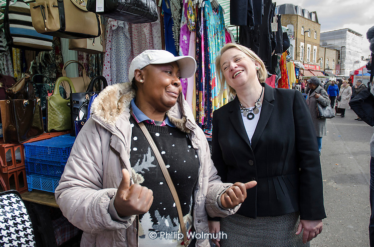 Green Party leader Natalie Bennett, with a stall holder at Ridley Road market, Dalston, London.