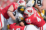October 17, 2009: Wisconsin Badgers defense tackles Iowa Hawkeyes running back Brandon Wegher (3) during an NCAA football game at Camp Randall Stadium on October 17, 2009 in Madison, Wisconsin. The Hawkeyes won 20-10. (Photo by David Stluka)