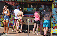 Tourists queue for refreshments<br /> People head to the beach at the popular seaside resort of Skegness as England has it's hottest day of the year with temperatures well into the 30 degrees celcius. Kegness, England, UK on June 25, 2020.<br /> CAP/ROS<br /> ©ROS/Capital Pictures