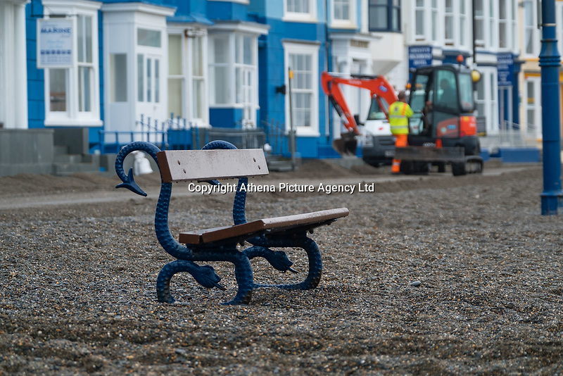 "Pictured: A bench is surrounded by debris on the promenade of the seaside town of Aberystwyth, Wales, UK. Monday 23 October 2017<br /> Re: A clean operation is under way at coastal parts of the UK were affected by Storm Brian.<br /> Roads in Aberystwyth's seafront and at nearby Aberaeron, Wales were shut on Saturday morning as a yellow ""be aware"" Met Office warning is in place."