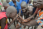 Students wash their hands before a meal in the Loreto Primary School in Rumbek, South Sudan. The Loreto Sisters began a secondary school for girls in 2008, with students from throughout the country, but soon after added a primary in response to local community demands.