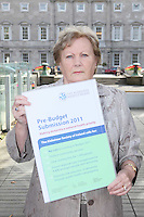 NO REPRO FEE. 7/10/2010. ALZHEIMER SOCIETY PRE-BUDGET SUBMISSION.  Carer Marjorie Dowling from Dublin who looks after her husband Christopher  took to the gates of the Dail during the launch of the charity's Pre-Budget Submission to call on the Government to help  the tens of thousands of people living with dementia in Ireland and their carers. The Alzheimer Society of Ireland has warned the Government that further funding cuts to its services in the coming Budget will see some of the 44,000 people living with dementia and their 50,000 carers left without even basic support though community services. The charity made its call at the launch of its Pre-Budget Submission 2011 as it revealed that many carers are now at crisis point as figures show waiting lists for dementia services have shot up by 33% in the last year.  Picture James Horan/Collins Photos