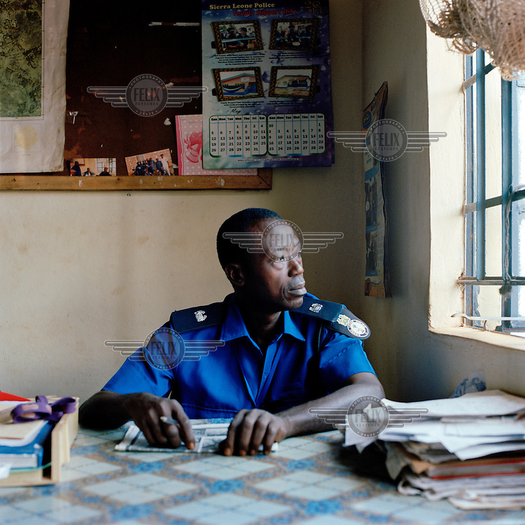 Usman Sahr Amara, operations director, sits at his desk at the central police station in Makeni.