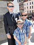 Joshua Meade who received his First Holy Communion in St. Peters Church pictured with his brothers Taylor and Jake. Photo:Colin Bell/pressphotos.ie