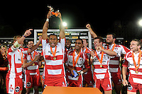 20130809 Copyright onEdition 2013 ©<br /> Free for editorial use image, please credit: onEdition.<br /> <br /> Akapusi Qera of Gloucester Rugby 7s holds the trophy aloft after winning the finals of the J.P. Morgan Asset Management Premiership Rugby 7s Series.<br /> <br /> The J.P. Morgan Asset Management Premiership Rugby 7s Series kicked off for the fourth season on Thursday 1st August with Pool A at Kingsholm, Gloucester with Pool B being played at Franklin's Gardens, Northampton on Friday 2nd August, Pool C at Allianz Park, Saracens home ground, on Saturday 3rd August and the Final being played at The Recreation Ground, Bath on Friday 9th August. The innovative tournament, which involves all 12 Premiership Rugby clubs, offers a fantastic platform for some of the country's finest young athletes to be exposed to the excitement, pressures and skills required to compete at an elite level.<br /> <br /> The 12 Premiership Rugby clubs are divided into three groups for the tournament, with the winner and runner up of each regional event going through to the Final. There are six games each evening, with each match consisting of two 7 minute halves with a 2 minute break at half time.<br /> <br /> For additional images please go to: http://www.w-w-i.com/jp_morgan_premiership_sevens/<br /> <br /> For press contacts contact: Beth Begg at brandRapport on D: +44 (0)20 7932 5813 M: +44 (0)7900 88231 E: BBegg@brand-rapport.com<br /> <br /> If you require a higher resolution image or you have any other onEdition photographic enquiries, please contact onEdition on 0845 900 2 900 or email info@onEdition.com<br /> This image is copyright the onEdition 2013©.<br /> <br /> This image has been supplied by onEdition and must be credited onEdition. The author is asserting his full Moral rights in relation to the publication of this image. Rights for onward transmission of any image or file is not granted or implied. Changing or deleting Copyright information is illegal as specified in the Copyright, Design and Patents Act 1988. If you are in any way unsure of your right to publish
