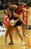 World 7 captain Natasha Chokljat collides with Temepara George during the International  Netball Series match between the NZ Silver Ferns and World 7 at TSB Bank Arena, Wellington, New Zealand on Monday, 24 August 2009. Photo: Dave Lintott / lintottphoto.co.nz