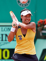 Kimiko Date Krumm (JPN) against Dinara Safina (RUS) (9) in the first round of the women's singles. Kimiko Date Krumm beat Dinara Safina 3-6 6-4 7-5..Tennis - French Open - Day 3 - Tue 25 May 2010 - Roland Garros - Paris - France..© FREY - AMN Images, 1st Floor, Barry House, 20-22 Worple Road, London. SW19 4DH - Tel: +44 (0) 208 947 0117 - contact@advantagemedianet.com - www.photoshelter.com/c/amnimages