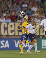 Sweden midfielder Lisa Dahlkvist (17) and US midfielder Kristine Lilly (13) battle for head ball. The US Women's national team beat Sweden, 3-0, at Rentschler Field on July 17, 2010.