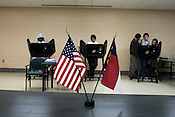 November 4, 2008. Burlington, NC.. Constant rains did not keep North carolina voters from the polls. Including early voting, NC was on its way to a record turnout for highly contested state and national races..The national and NC state flags stood on a table at a polling station in a home for the elderly.