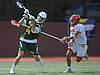 Zach Hobbes #4 of Ward Melville, left, takes a shot at the net as Roy Meyer #31 of Chaminade pressures him during a non-league varsity boys lacrosse game at Chaminade High School on Saturday, April 7, 2018. Ward Melville won by a score of 11-7.
