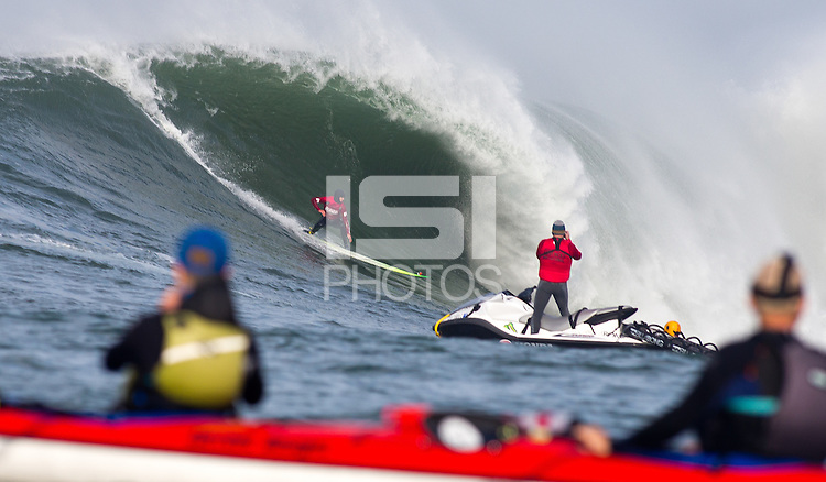 Half Moon Bay, California - January 24, 2014: 2014 Maverick's Invitational Zach Wormhoudt dropping in a small one.