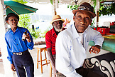 JAMAICA, Port Antonio. The Jolly Boys, a Mento band, having drinks at Marybelle's Pub on the Pier.