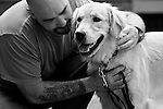 BEACON, NEW YORK:  Phil, in prison for manslaughter, works intensely with Jack as part of the training in Puppies Behind Bars program at Fishkill Correctional Facility. Phil says that Jack is very hard-headed and stubborn at times so he has to give commands in a stern voice, but he acknowledges that it has taken the puppy less time to learn the commands than it's taken him to learn how to teach them. The program works with prison inmates in New York, New Jersey, and Connecticut to train service dogs, including ones who help injured soldiers or those suffering from post-traumatic stress. The puppies live with the prisoners during a 18-24-month training process.
